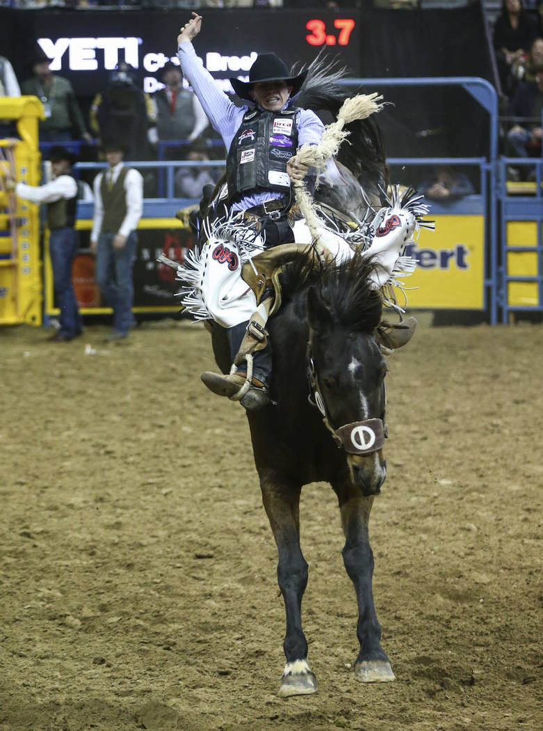 Chase Brooks of Deer Lodge, Mont. competes in saddle bronc riding during the opening night of the National Finals Rodeo at the Thomas & Mack Center in Las Vegas on Thursday, Dec. 6, 2018. Chas ...