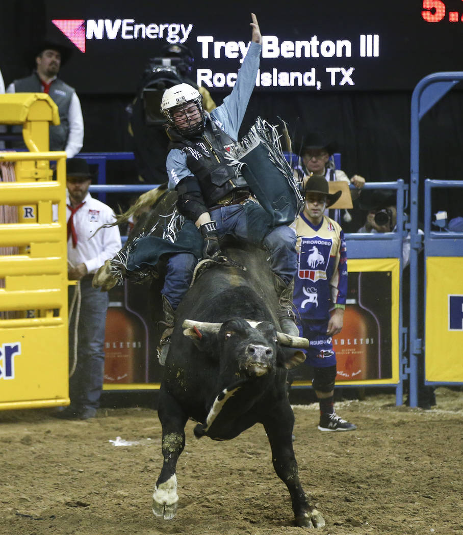 """Trey Benton III of Rock Island, Texas rides """"VJV Whiskey Hand"""" while competing in bull riding during the opening night of the National Finals Rodeo at the Thomas & Mack Center in Las ..."""