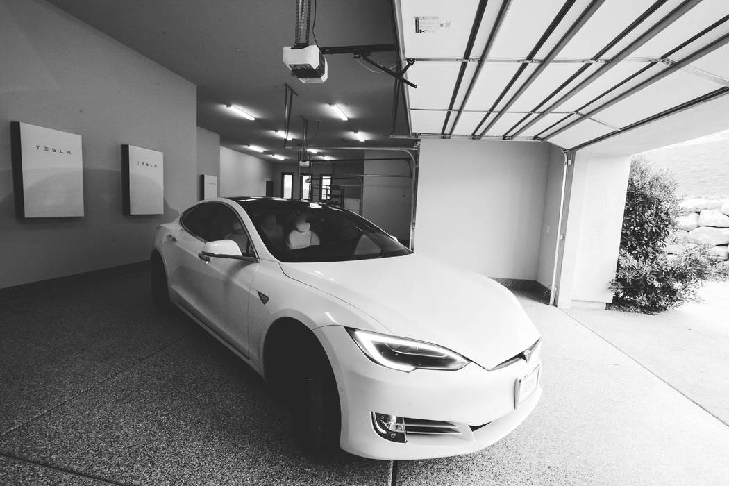 The luxury estate at 27 Shadow Canyon Court in Southern Highlands has a six-car garage houses the integrated Tesla Power System and a Tesla electric car. (Growth Luxury Homes)
