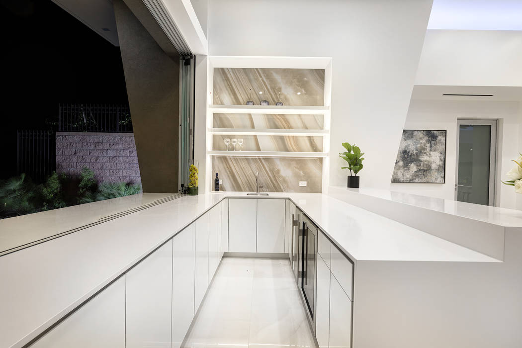 The bar near the kitchen has a service window that opens to the patio. (Richard Luke Architects)