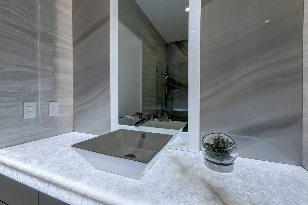 Each of the three bedrooms has its own bath. (Richard Luke Architects)