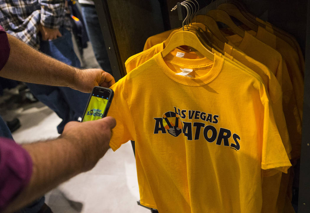 Baseball fans check out apparel with the new logo and name of Las Vegas' Triple-A baseball team, Las Vegas Aviators, after the unveiling at Downtown Summerlin in Las Vegas on Saturday, Dec. 8, 201 ...