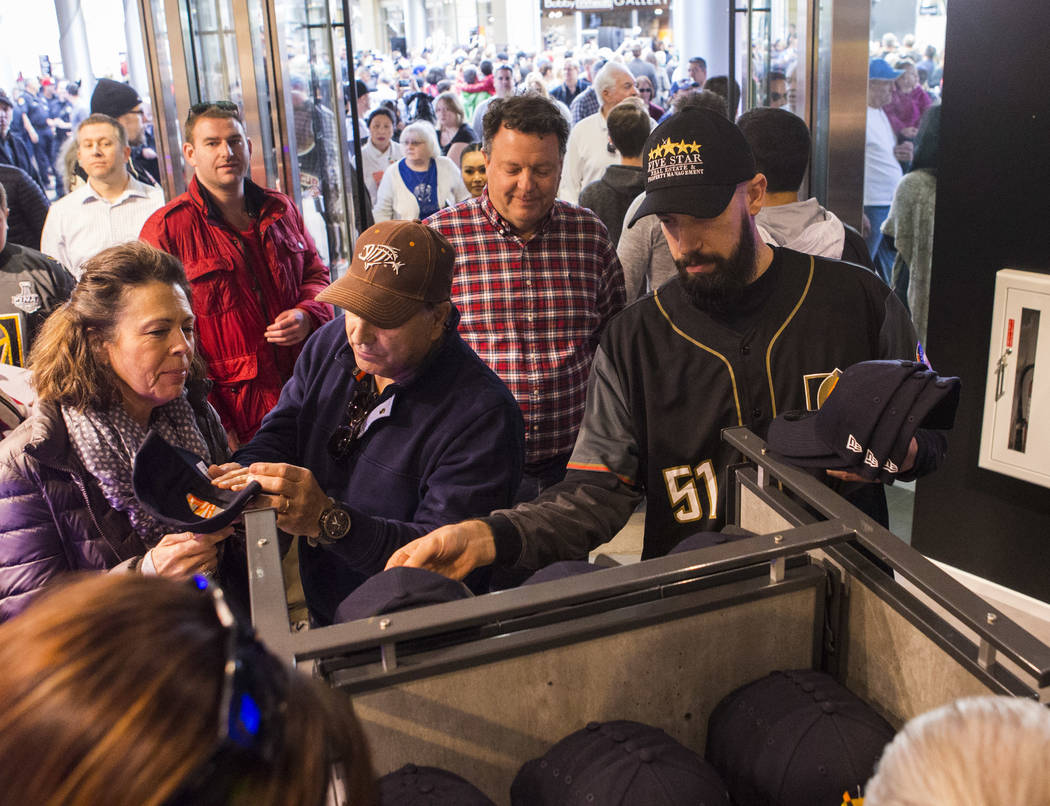Baseball fans, including Matthew Kammeyer, right, check out apparel with the new logo and name of Las Vegas' Triple-A baseball team, Las Vegas Aviators, after the unveiling at Downtown Summerlin i ...