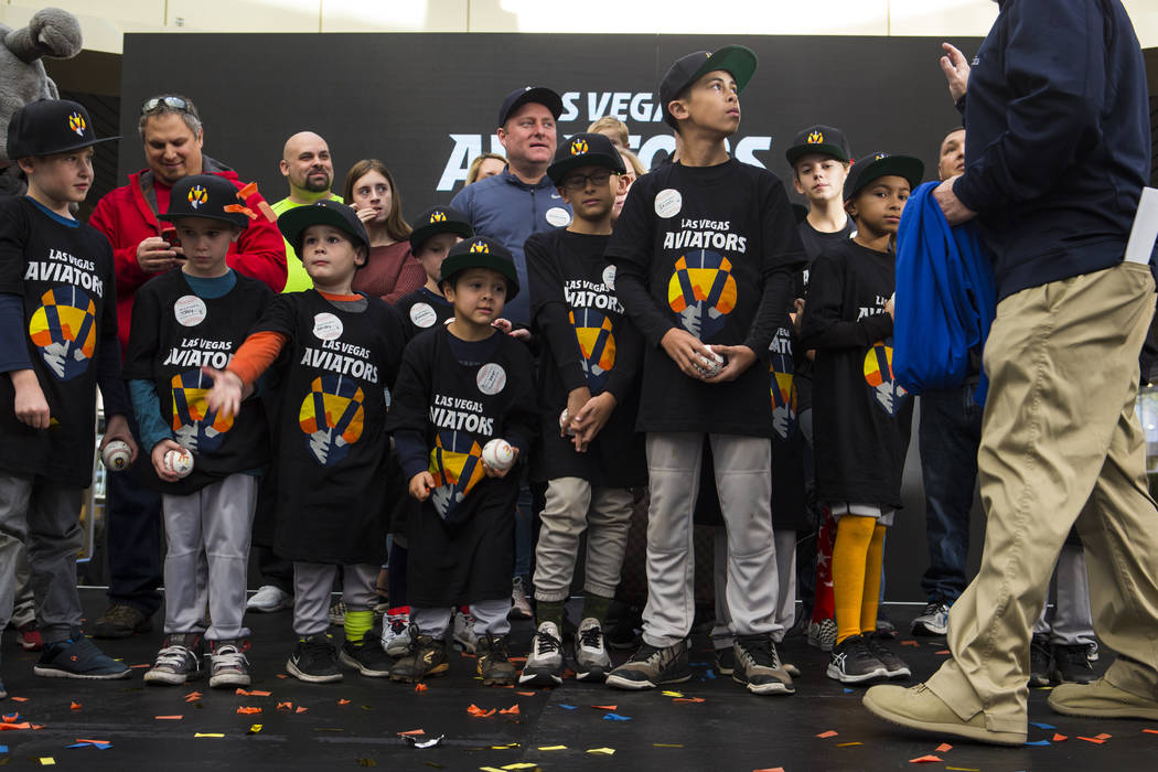 Youth baseball players wear apparel with the new logo and name of Las Vegas' Triple-A baseball team, Las Vegas Aviators, after the unveiling at Downtown Summerlin in Las Vegas on Saturday, Dec. 8, ...