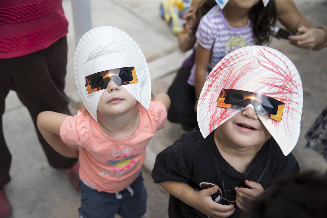 Amilya Durnen, 3, left, and Joseph Hernandez-Bernabei, 3, watch the solar eclipse at the Keeping Youth Educated daycare in Las Vegas, on Monday, Aug. 21, 2017. Erik Verduzco Las Vegas Review-Journ ...