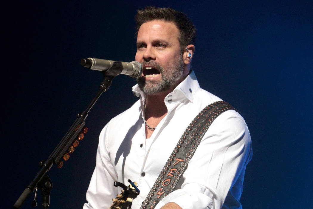 Troy Gentry of the Country Music duo Montgomery Gentry performs on the Rebels On The Run Tour in Lancaster, Pa. on .Jan. 17, 2013. (Owen Sweeney/Invision/AP, File)
