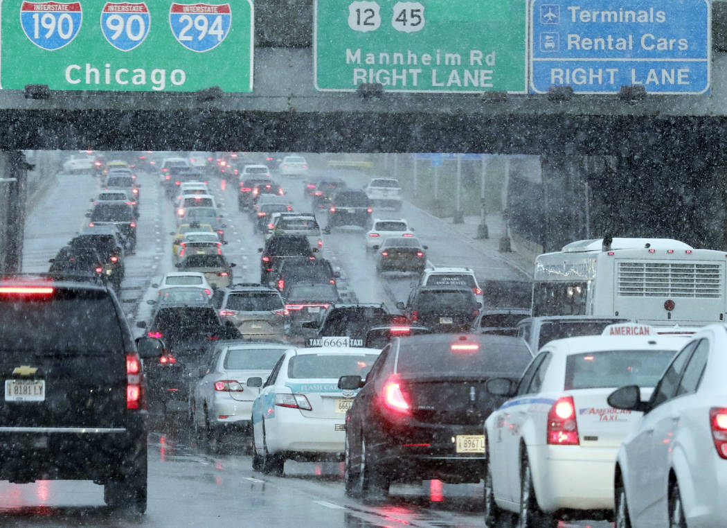 Heavy traffic is seen on Interstate 190 near O'Hare International Airport in Chicago, Sunday, Nov. 25, 2018. A winter storm is expected to dump snow across the Midwest, on one of the busiest trave ...