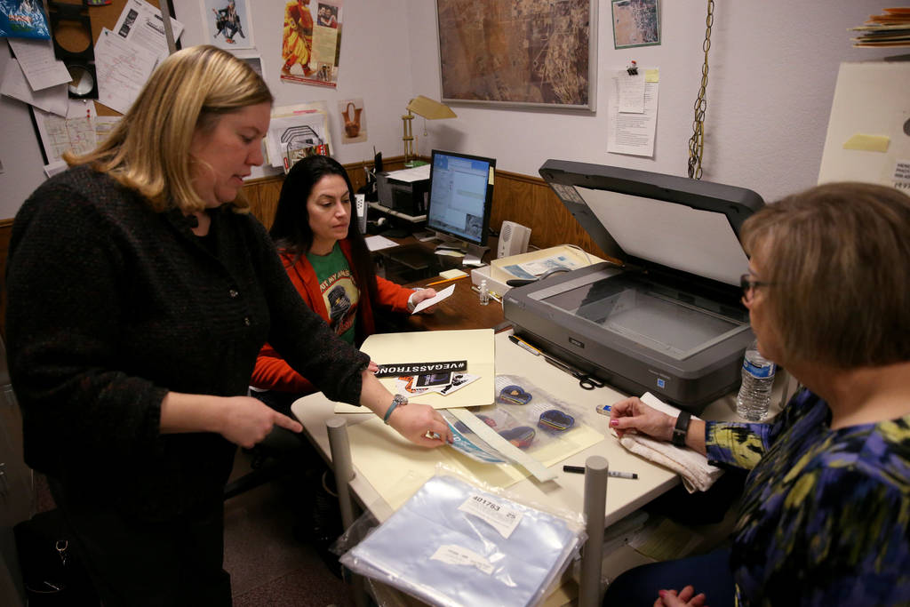 Clark County Museum Registrar Cynthia Sanford, left, and volunteers Ilene Bernal, right, and Erin Luebke re-house the final items Thursday, Dec. 6 2018, of the more than 17,000 items left at the m ...