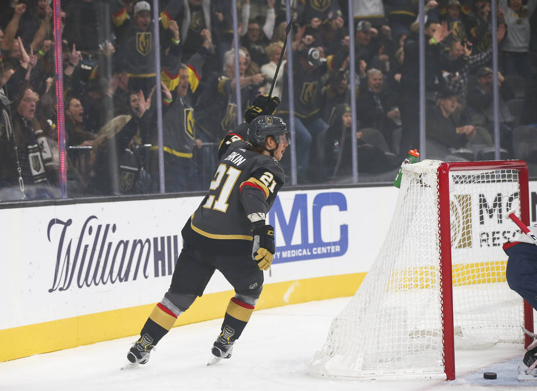 Golden Knights center Cody Eakin (21) celebrates a goal by Golden Knights right wing Ryan Reaves, not pictured, during the first period of an NHL hockey game against the Washington Capitals at T-M ...