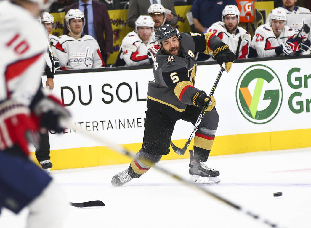 Golden Knights defenseman Deryk Engelland (5) passes the puck during the first period of an NHL hockey game against the Washington Capitals at T-Mobile Arena in Las Vegas on Tuesday, Dec. 4, 2018. ...