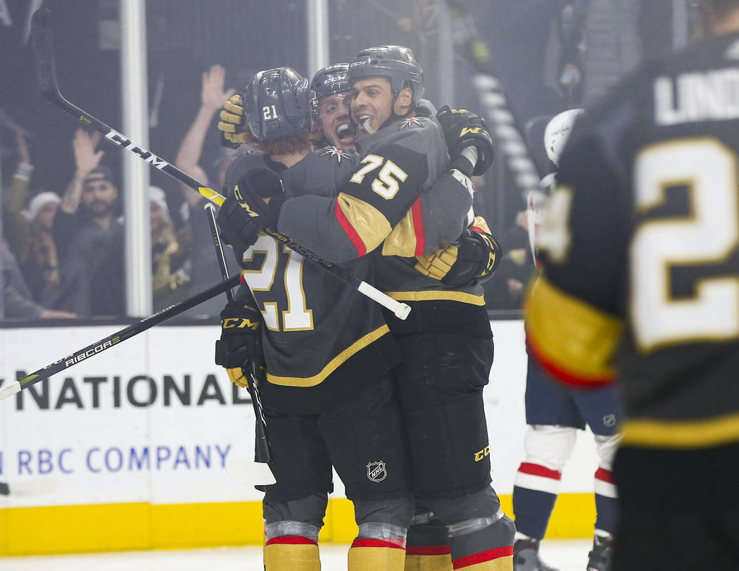 Golden Knights right wing Ryan Reaves (75) celebrates his goal with Cody Eakin, left, and Nate Schmidt during the first period of an NHL hockey game against the Washington Capitals at T-Mobile Are ...