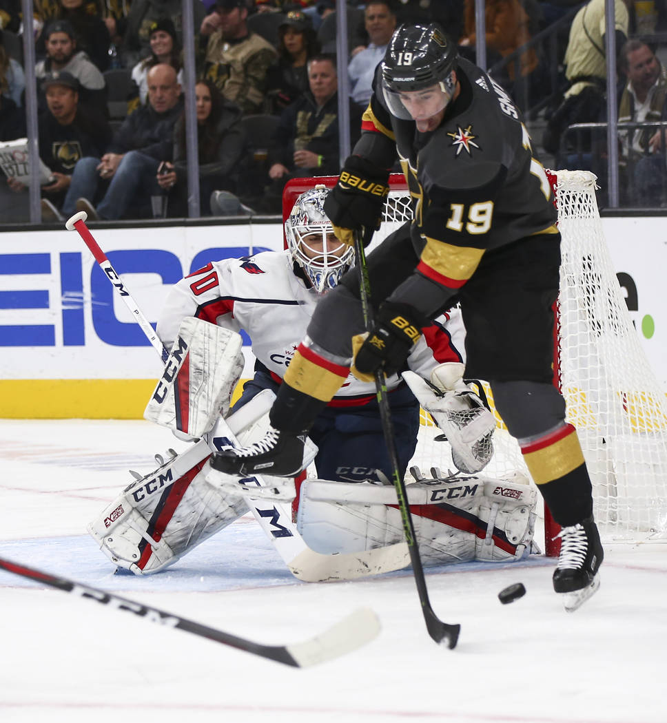 Golden Knights right wing Reilly Smith (19) tries to redirect a shot in front of Washington Capitals goaltender Braden Holtby (70) during the second period of an NHL hockey game at T-Mobile Arena ...