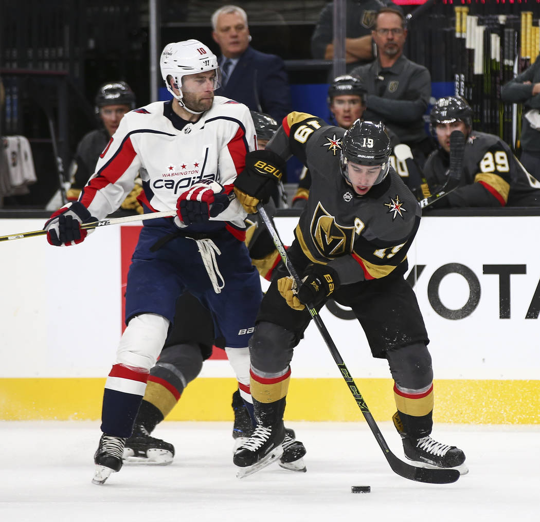 Golden Knights right wing Reilly Smith (19) moves the puck around Washington Capitals right wing Brett Connolly (10) during the second period of an NHL hockey game at T-Mobile Arena in Las Vegas o ...