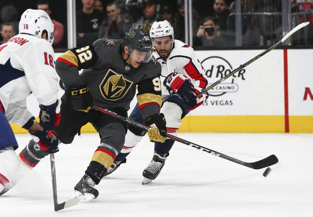 Golden Knights left wing Tomas Nosek (92) moves the puck past Washington Capitals defenseman Matt Niskanen (2) during the second period of an NHL hockey game at T-Mobile Arena in Las Vegas on Tues ...