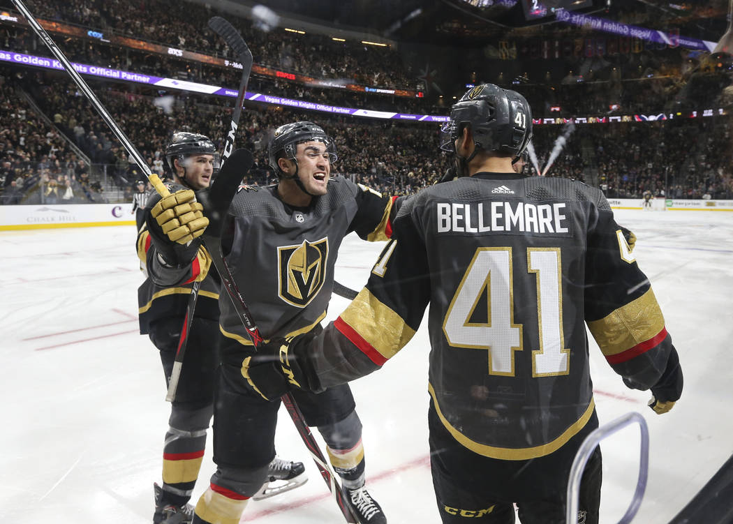 Golden Knights center Pierre-Edouard Bellemare (41) celebrates his goal against the Washington Capitals with Golden Knights left wing William Carrier, center, during the third period of an NHL hoc ...