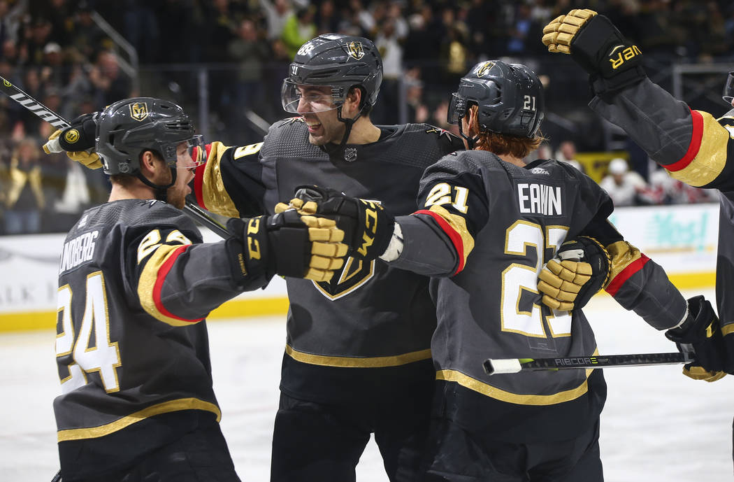 Golden Knights center Cody Eakin (21) celebrates his goal with teammates Oscar Lindberg (24) and Alex Tuch during the third period of an NHL hockey game against the Washington Capitals at T-Mobile ...