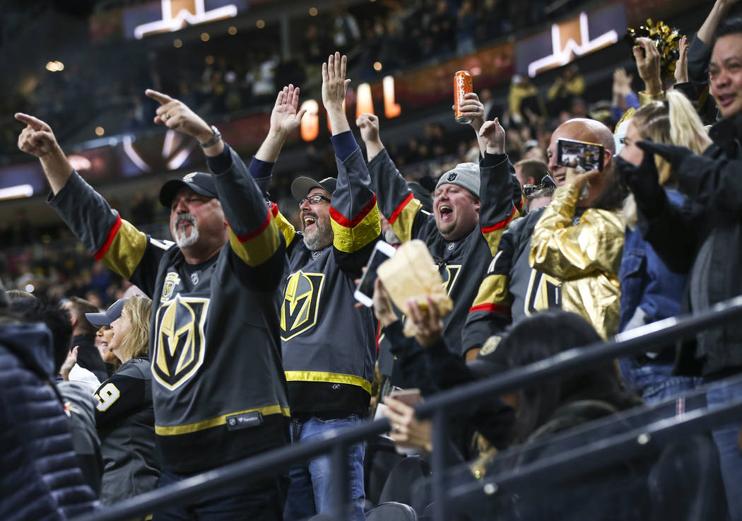 Golden Knights fans celebrate a goal by Golden Knights center Cody Eakin, not pictured, during the third period of an NHL hockey game at T-Mobile Arena in Las Vegas on Tuesday, Dec. 4, 2018. Chase ...
