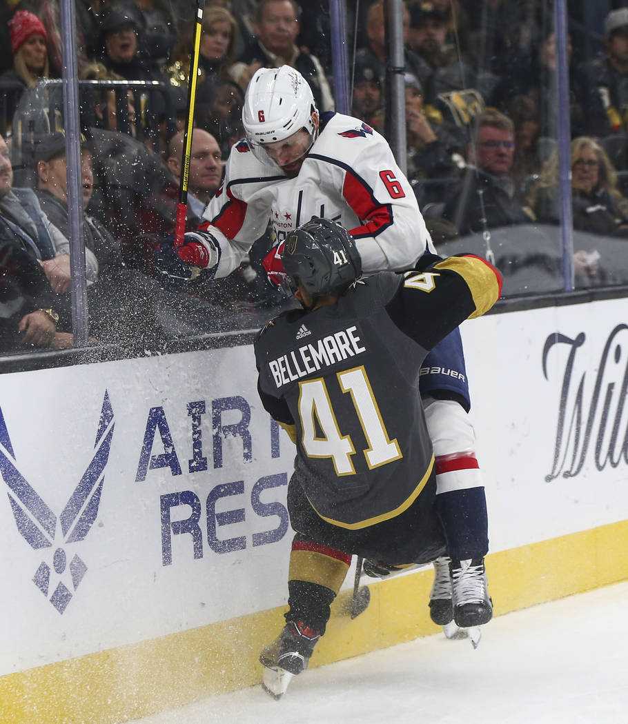 Golden Knights center Pierre-Edouard Bellemare (41) collides with Washington Capitals defenseman Michal Kempny (6) during the third period of an NHL hockey game at T-Mobile Arena in Las Vegas on T ...