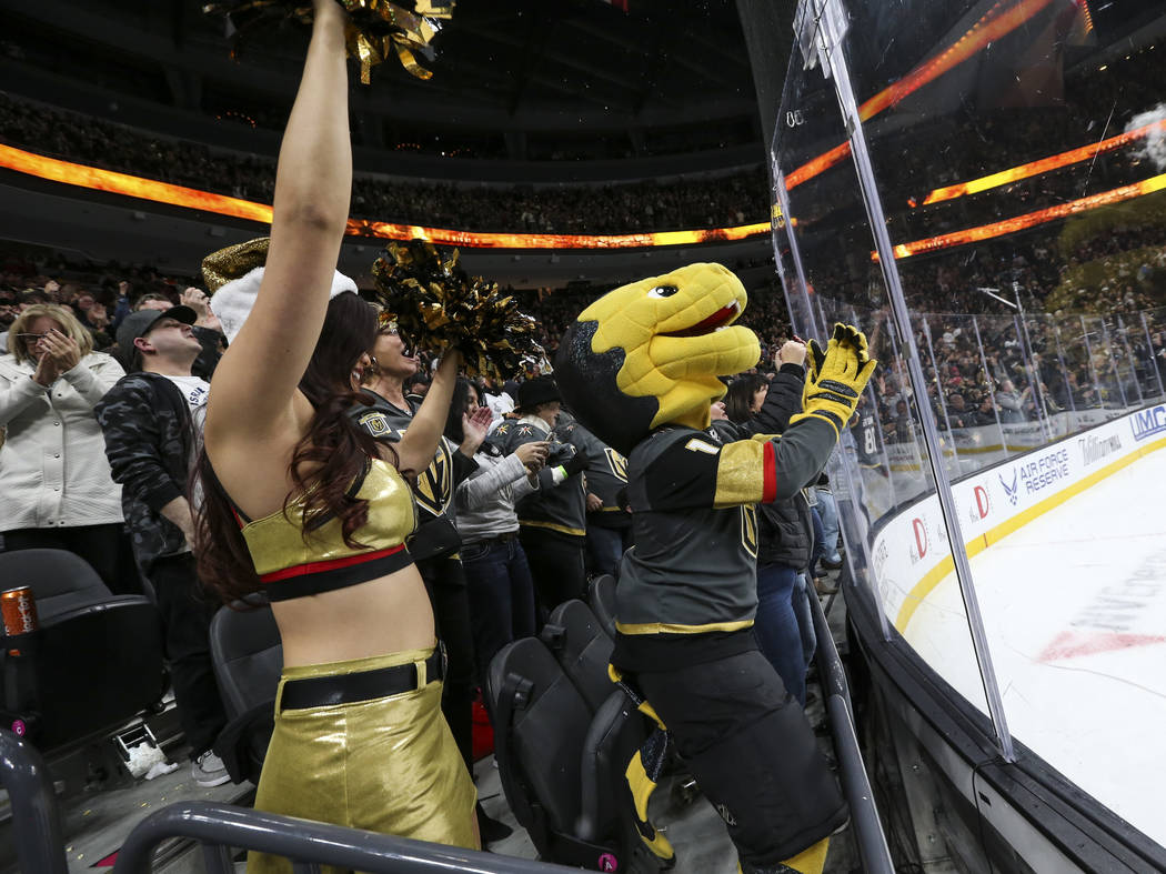 Golden Knights mascot Chance celebrates a goal by defenseman Nate Schmidt, not pictured, during the third period of an NHL hockey game against the Washington Capitals at T-Mobile Arena in Las Vega ...