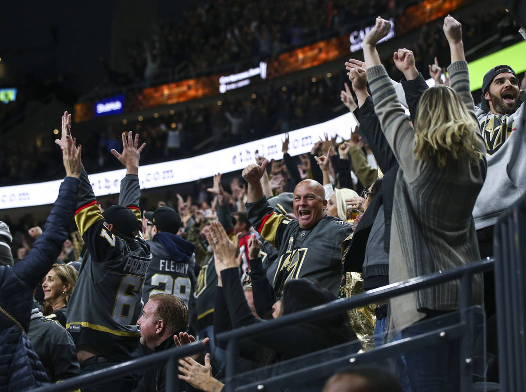 Golden Knights fans celebrate an empty-net goal against the Washington Capitals during the third period of an NHL hockey game at T-Mobile Arena in Las Vegas on Tuesday, Dec. 4, 2018. Chase Stevens ...