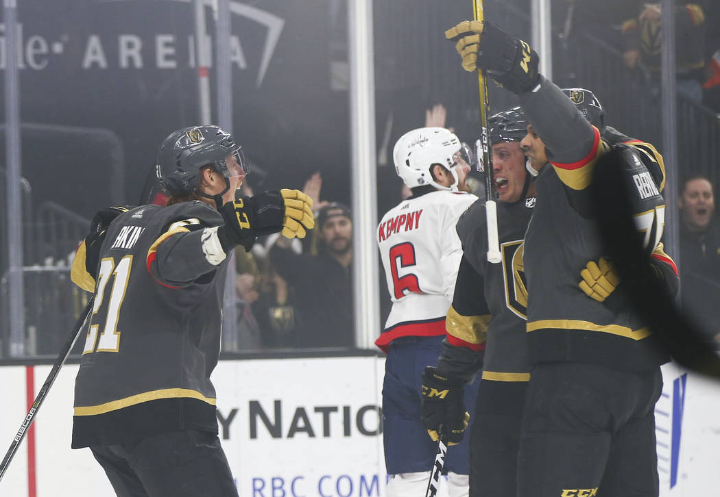 Golden Knights right wing Ryan Reaves, far right, celebrates his goal with Cody Eakin, left, and Nate Schmidt during the first period of an NHL hockey game against the Washington Capitals at T-Mob ...