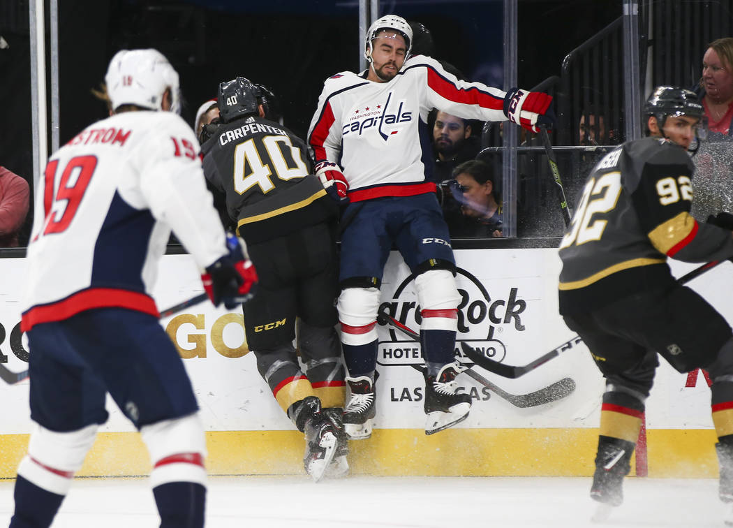 Golden Knights center Ryan Carpenter (40) slams Washington Capitals defenseman Matt Niskanen into the glass during the second period of an NHL hockey game at T-Mobile Arena in Las Vegas on Tuesday ...