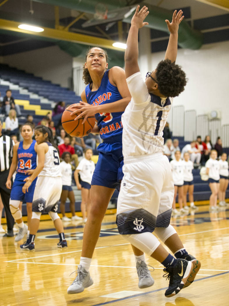 Bishop Gorman's Georgia Ohiaeri (3) looks for a shot as Spring Valley's Deja McDonald (1) defends during the first half of a varsity basketball game at Spring Valley High School in Las Vegas on Tu ...
