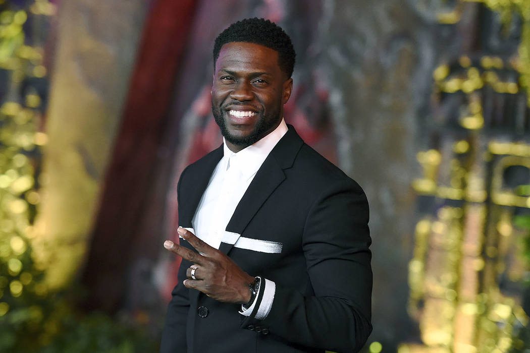 "In this Dec. 11, 2017 file photo, Kevin Hart arrives at the Los Angeles premiere of ""Jumanji: Welcome to the Jungle"" in Los Angeles. Hart will host the 2019 Academy Awards, fulfilling a lifelong d ..."