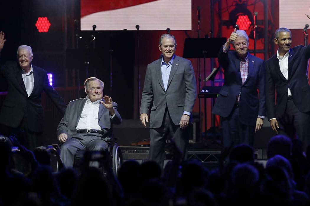 In this Oct. 21, 2017, file photo, former presidents from right, Barack Obama, Bill Clinton, George W. Bush, George H.W. Bush and Jimmy Carter gather on stage at the opening of a hurricanes relief ...
