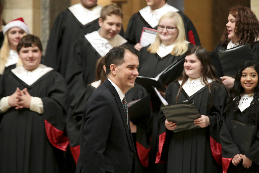 Wisconsin Gov. Scott Walker arrives for the lighting of the state Christmas Tree in the Capitol Rotunda, Tuesday, Dec. 4, 2018 at the Capitol in Madison, Wis. The Senate and Assembly are set to se ...