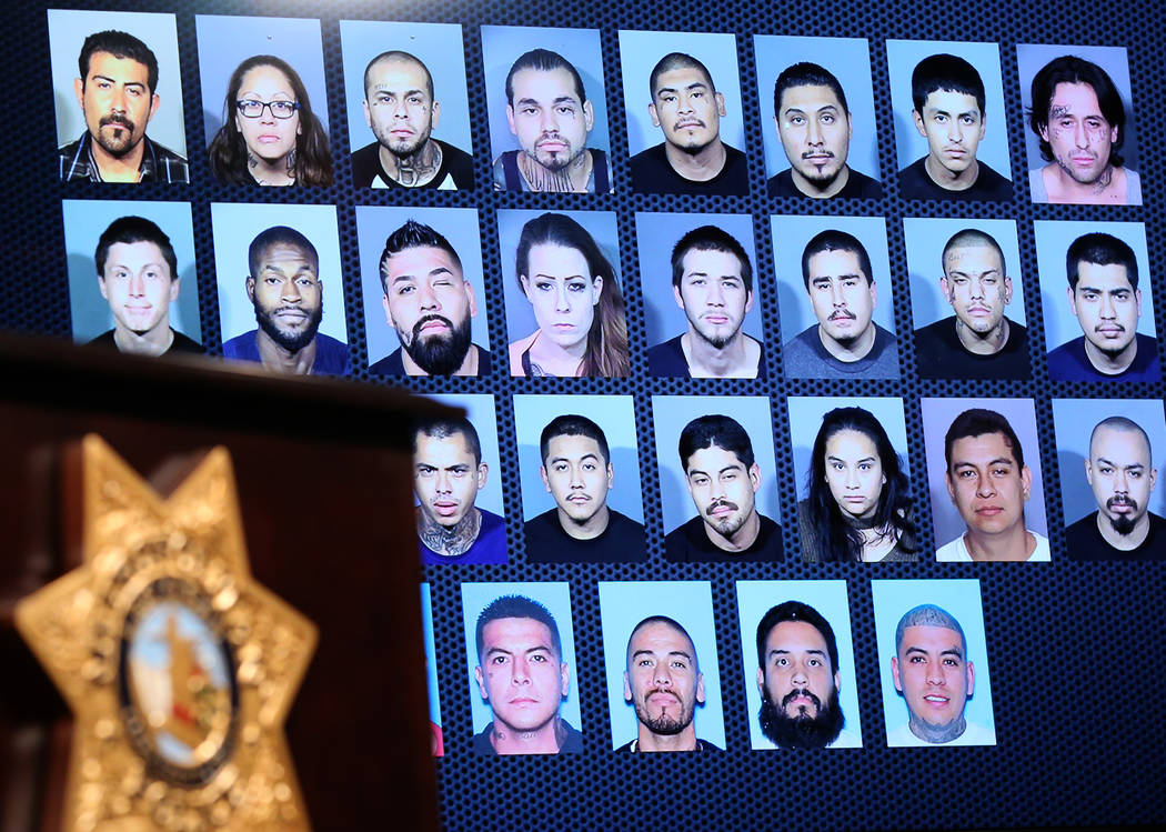 Photos of gang members and the names of their gangs are displayed on Wednesday, Dec. 5, 2018 at the LVMPD Headquarters as LVMPD Gang Crime Unit commanders held a news conference to announce the re ...