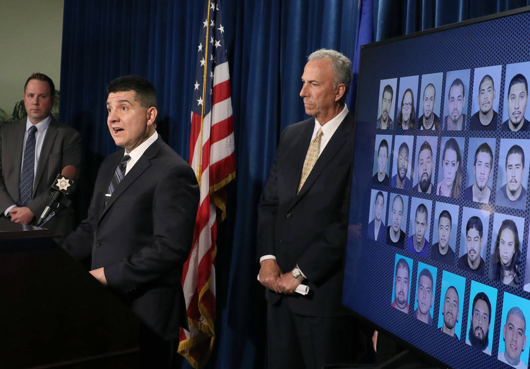 Lt. John Leon of Metro's gang unit, center, speaks on Wednesday, Dec. 5, 2018 as Lt. Reggie Rader of Metro's gang, left, and District Attorney Steve Wolfson look on at the LVMPD Headquarters where ...