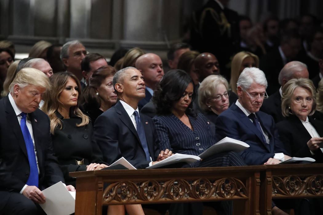 From left, President Donald Trump, first lady Melania Trump, former President Barack Obama, Michelle Obama, former President Bill Clinton and former Secretary of State Hillary Clinton listen durin ...