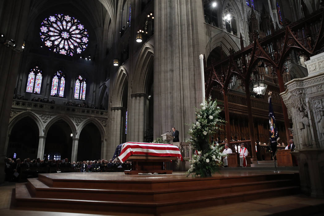 Former President George W. Bush speaks during the State Funeral for his father, former President George H.W. Bush, at the National Cathedral, Wednesday, Dec. 5, 2018, in Washington.(AP Photo/Alex ...