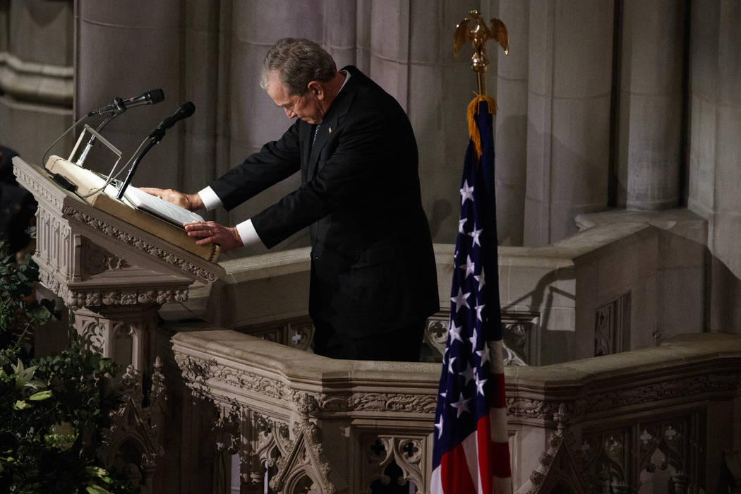 Former President George W. Bush fights back tears as he speaks during the State Funeral for his father, former President George H.W. Bush, at the National Cathedral, Wednesday, Dec. 5, 2018, in Wa ...