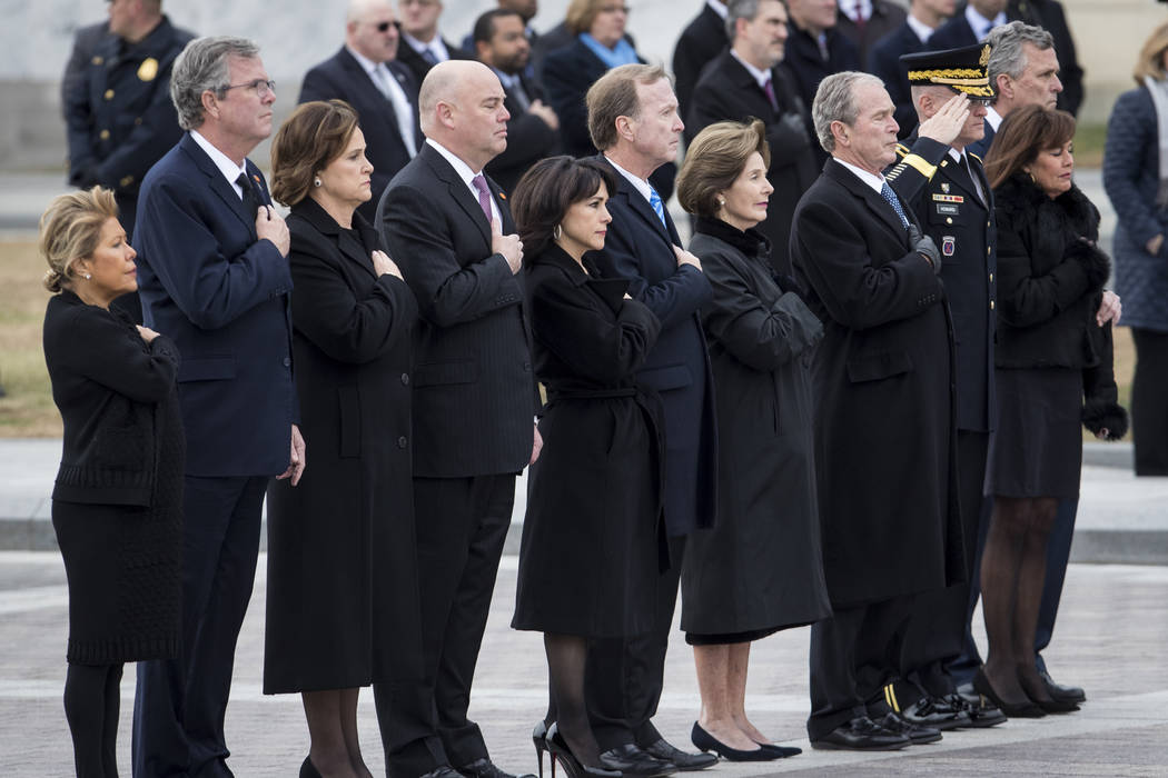 Members of the Bush family look on as the casket of former President George H.W. Bush is transported from the U.S. Capitol to the National Cathedral Wednesday, Dec. 5, 2018. (Sarah Silbiger/The Ne ...