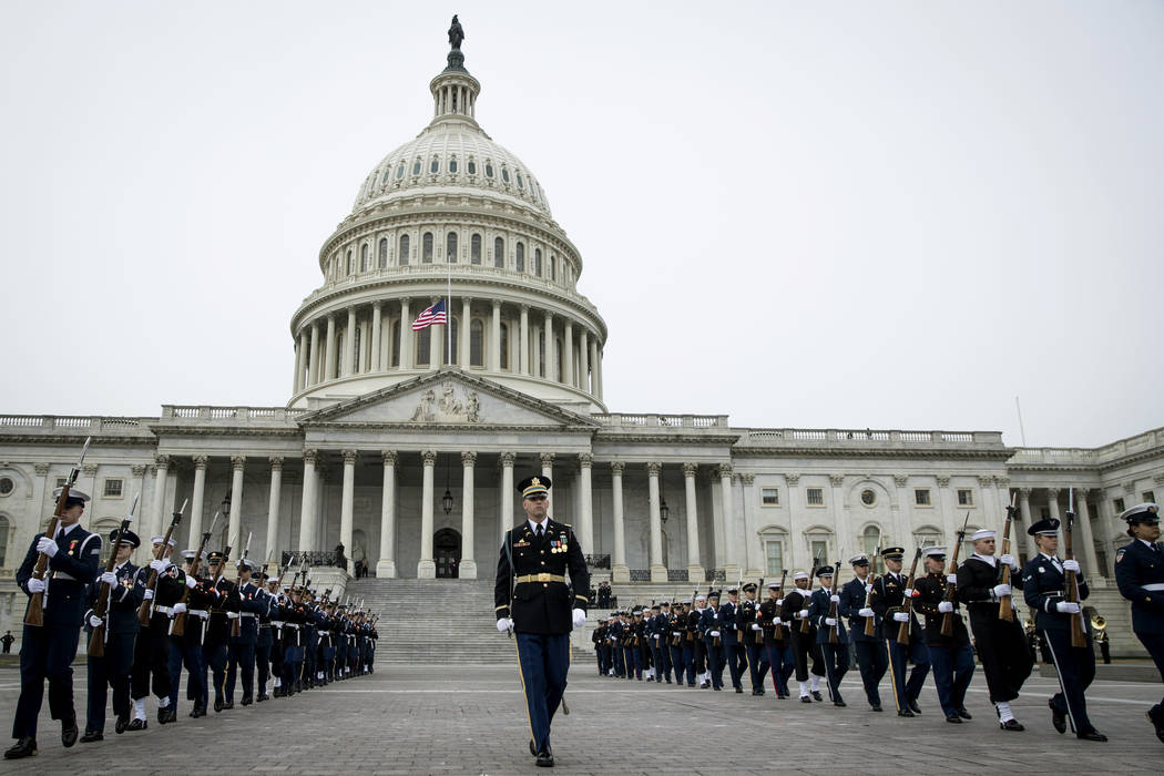 Service members depart from the Capitol after the flag-draped casket of former President George H.W. Bush was transported from the U.S. Capitol to the National Cathedral Wednesday Dec. 5, 2018, in ...