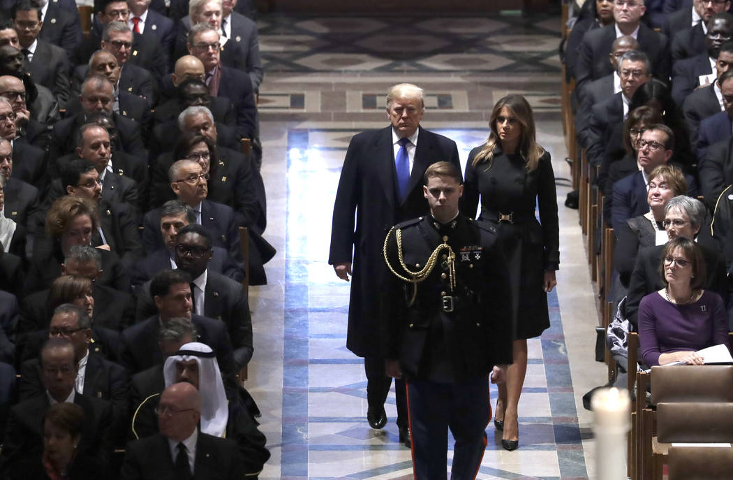 President Donald Trump and first lady Melania Trump arrive for the State Funeral former President George H.W. Bush, at the National Cathedral, Wednesday, Dec. 5, 2018, in Washington. (AP Photo/Eva ...