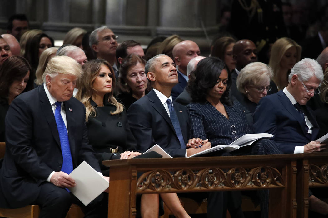 From left, President Donald Trump, first lady Melania Trump, former President Barack Obama, Michelle Obama, and former President Bill Clinton listen during a State Funeral at the National Cathedra ...