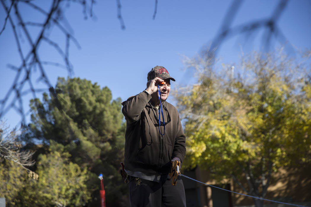 Paul Dzerk, UNLV campus arborist , uses a clinometer to measure the height of a Weeping Mulberry Tree on Thursday, Dec. 13, 2018, at UNLV, in Las Vegas. Benjamin Hager Las Vegas Review-Journal