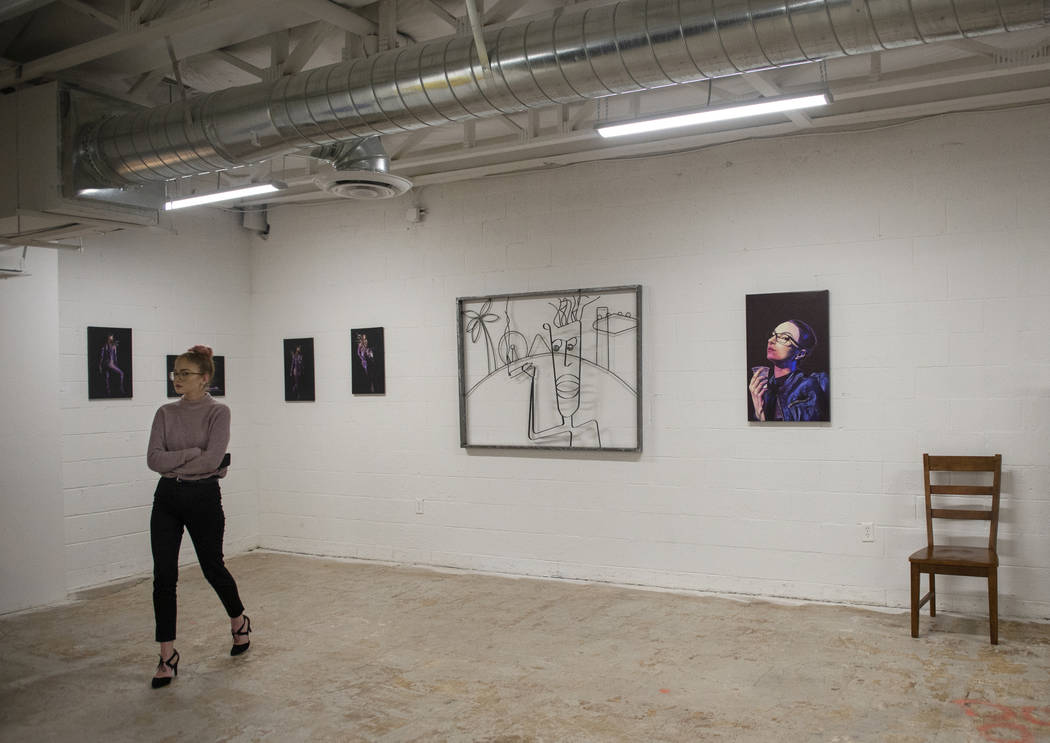 Summer Bontrager walks through an exhibit at Core Contemporary Gallery in Las Vegas, Thursday, Dec. 6, 2018. Caroline Brehman/Las Vegas Review-Journal