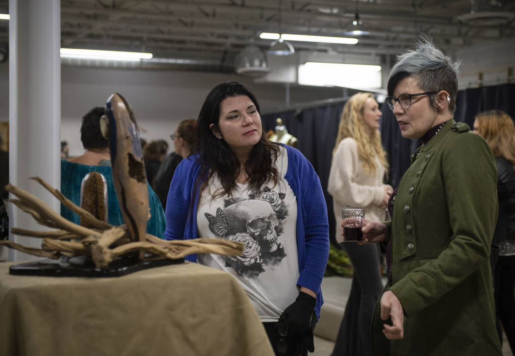 "Lisa Dittrich, left, talks with artist Renee McHenry about her piece ""EMERGENCE"" on display at an exhibit at Core Contemporary Gallery in Las Vegas, Thursday, Dec. 6, 2018. Caroline Breh ..."