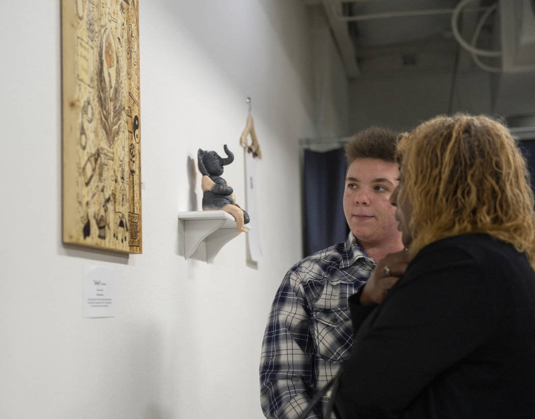 "Artist Elijah Brown talks with his teacher LaToria Kern about his piece ""Salvaje"" on display at Core Contemporary Gallery in Las Vegas, Thursday, Dec. 6, 2018. Caroline Brehman/Las Vegas ..."