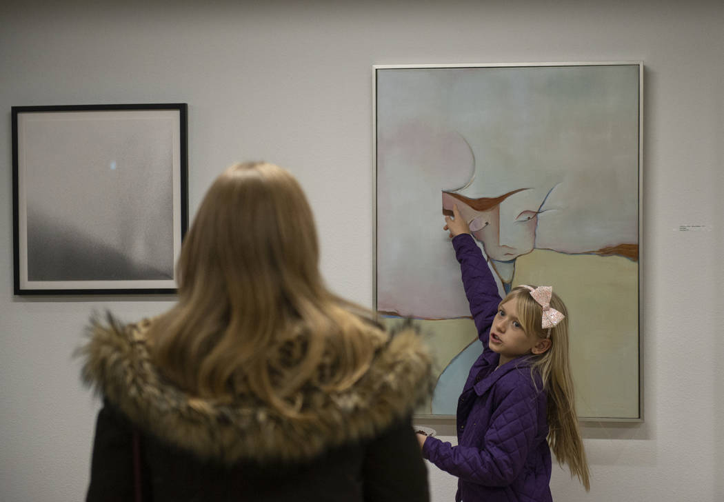 "Diana Orz, 10, from Las Vegas points to the artwork ""FEATHER HEAD"" by Gail Gilbert on display at Core Contemporary Gallery in Las Vegas, Thursday, Dec. 6, 2018. Caroline Brehman/Las Vegas Review-J ..."