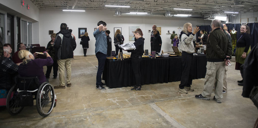 Attendees gather for an exhibit at Core Contemporary Gallery in Las Vegas, Thursday, Dec. 6, 2018. Caroline Brehman/Las Vegas Review-Journal