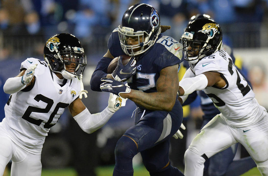 Tennessee Titans running back Derrick Henry (22) runs for a touchdown against Jacksonville Jaguars cornerback Jalen Ramsey (20) during the second half of an NFL football game, Thursday, Dec. 6, 20 ...