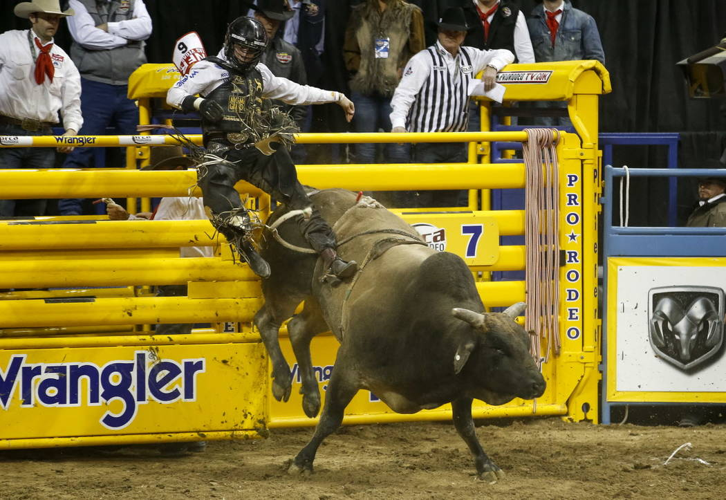 Sage Kimzey of Strong City, Oklahoma is bucked from Jack Shot in the bull riding competition during the ninth go-round of the National Finals Rodeo, Friday, Dec. 15, 2017, at the Thomas & Mack ...