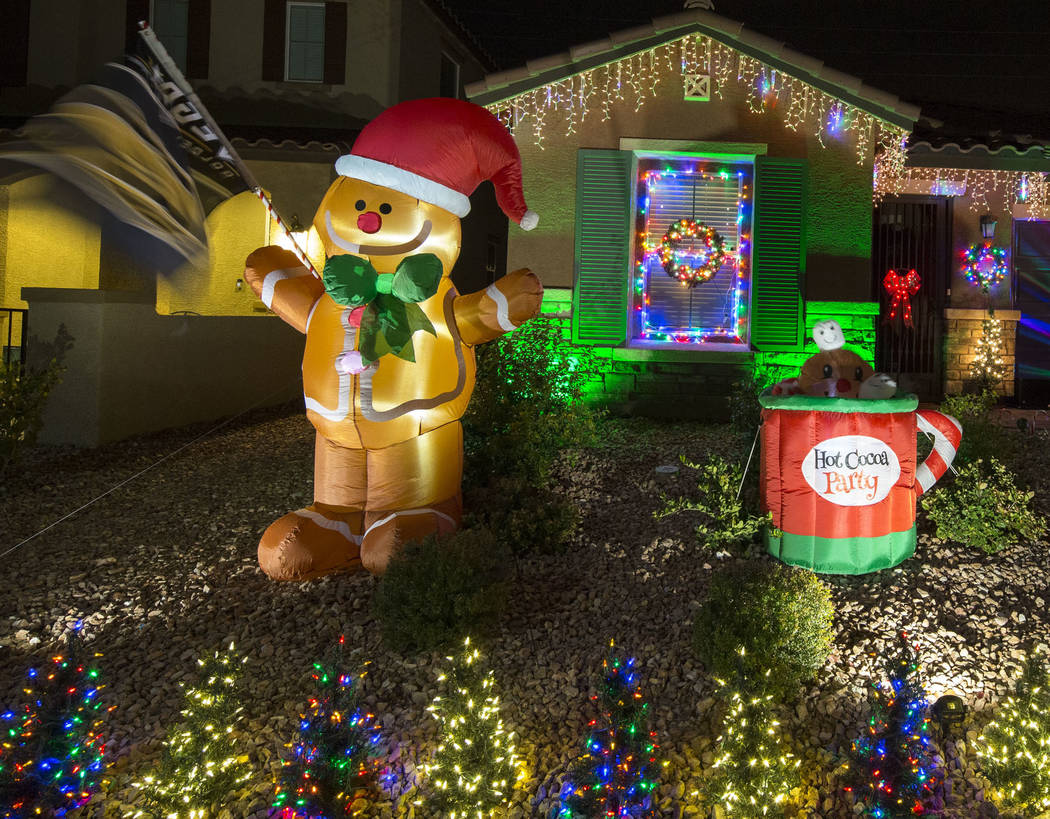 The house of Becky and GG Misa is seen decorated with a Christmas light display that is synchronized to the entrance music for the Golden Knights located at 730 Bollons Island St. in Henderson on ...