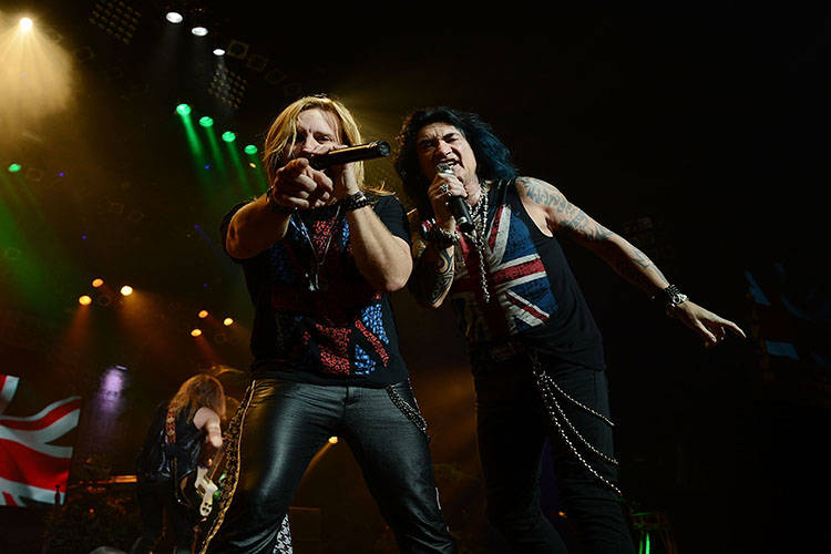 Andrew Freeman and Robin McAuley perform in Raiding the Rock Vault at the Las Vegas Hotel on March 4, 2014 in Las Vegas, Nevada. (Photo by Denise Truscello/WireImage)