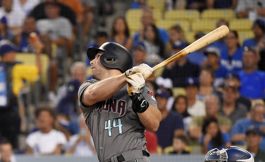 In this Aug. 31, 2018 file photo Arizona Diamondbacks' Paul Goldschmidt hits a two-run home run during the first inning of a baseball game against the Los Angeles Dodgers in Los Angeles. The St. L ...